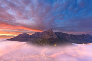 Beautiful Table Mountain Sunrise with Mist. South Africa Photo Tours