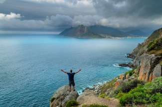 Chapmans Peak beautiful Ocean View with man. South Africa Photo Tours