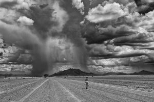 Photographing the storm, photographer in Namibia. Private Photo Tours