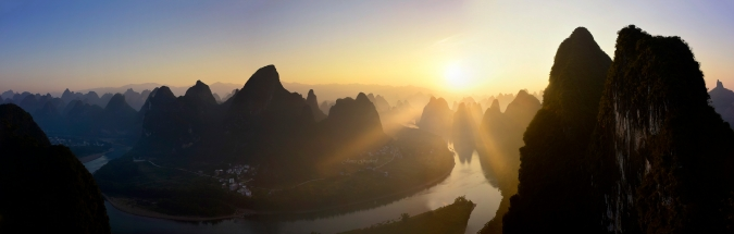 Panoramic image of sunrise in the Quilin Karstlands. Photo Tour China