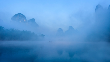 Fisherman in the Mist. China Photo Tour