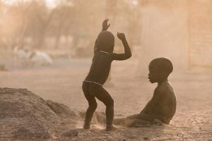 Himba Boys playing in dust, Kamanjab. Namibia Photo Tours