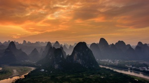 Karst Mountian sunset above town of Xingping. Photo Tour China