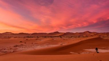 Photographer with Beautiful Sossusvlei Sunset. Namibia photo tours