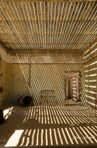 Kolmanskop Ghost Town room with contrasting light. Namibia photo tours