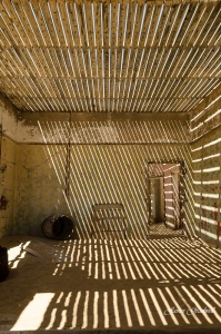 Kolmanskop Ghost Town room with contrasting light. Copyright James Gradwell